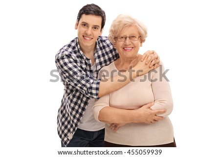 Studio shot of a young man hugging a senior lady isolated on white background - stock photo