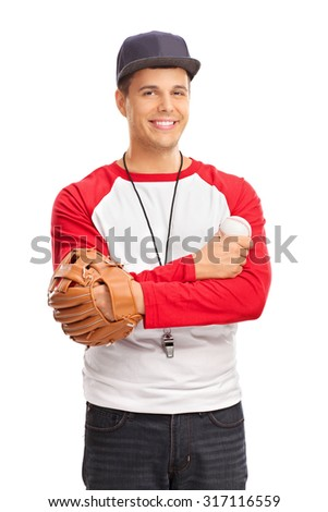 Studio shot of a young man with a baseball glove holding a baseball and wearing a whistle around his neck isolated on white background