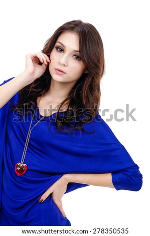 Studio shot of a young woman in blue dress - stock photo