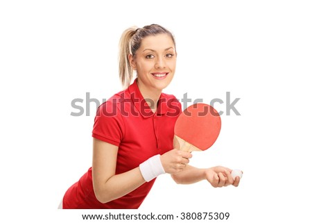 Studio shot of a young woman playing ping pong and looking at the camera isolated on white background - stock photo