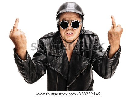Studio shot of an angry senior biker showing middle finger with both hands and looking at the camera isolated on white background - stock photo