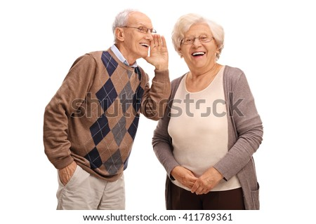Studio shot of an old man whispering something to his wife isolated on white background - stock photo