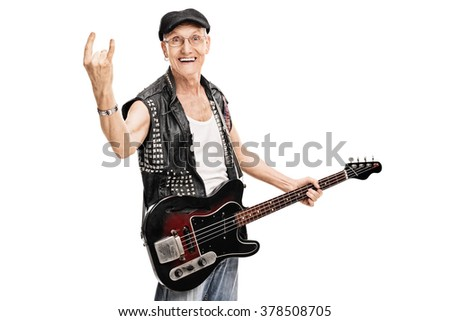 Studio shot of an old punk rocker holding a bass guitar and making a rock gesture isolated on white background - stock photo