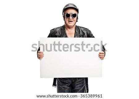 Studio shot of an old-school senior biker holding a white banner isolated on white background - stock photo