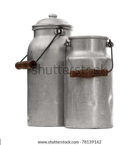 studio shot of an two old and worn out milk can with a handle - stock photo