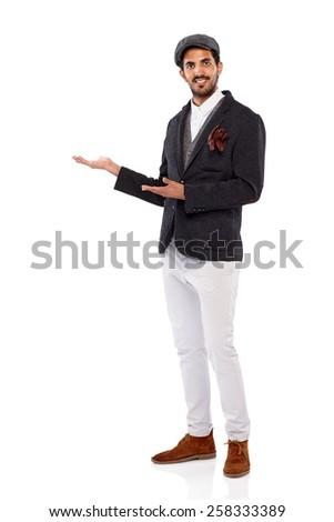 Studio shot of attractive young indian man showing empty copyspace for your advertisement on white background - stock photo