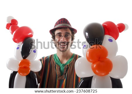 Studio shot of Balloon twister with penguins and balloons isolated on white. - stock photo