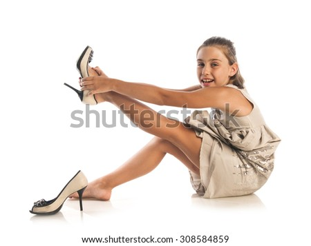 Studio shot of beautiful girl wearing fashion shoes looking at camera, isolated on white background - stock photo