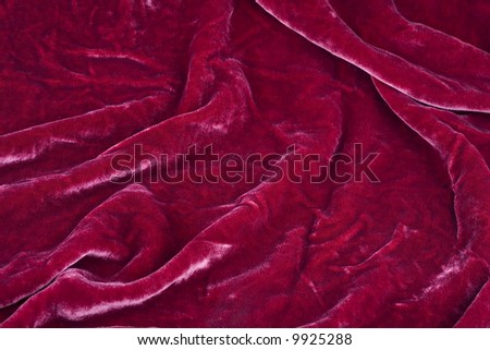 Studio shot of beautiful red soft wine-coloured velvet background - stock photo