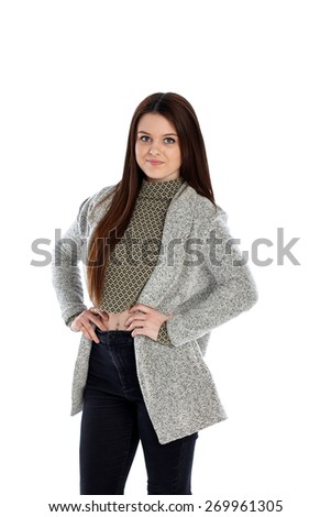 Studio shot of beautiful young girl posing with her hands on hips on white background - stock photo