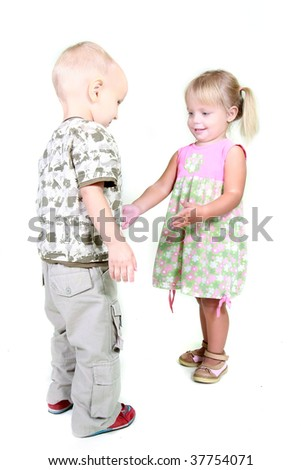 studio shot of boy and girl playing together
