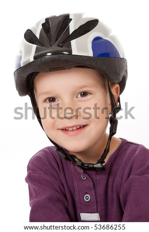 studio shot of boy in bicycle helmets - stock photo