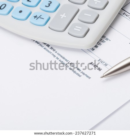 Studio shot of calculator and pen over some receipt - accounting concept - stock photo