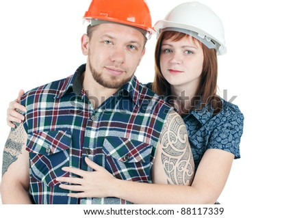 Studio shot of caucasian couple in hard hats, isolated over a white background - stock photo