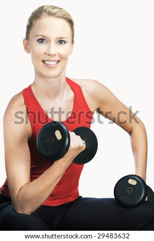Studio shot of caucasian model holding a dumb bell and posing - stock photo