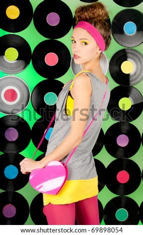 studio shot of cheerful teenage girl on the colorful background - stock photo