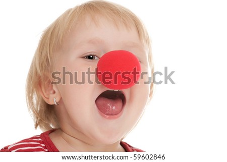 studio shot of child with clown nose - stock photo