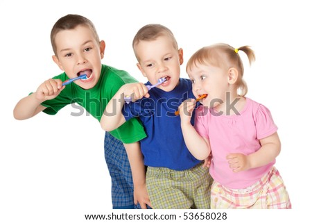 studio shot of children to brush his teeth - stock photo