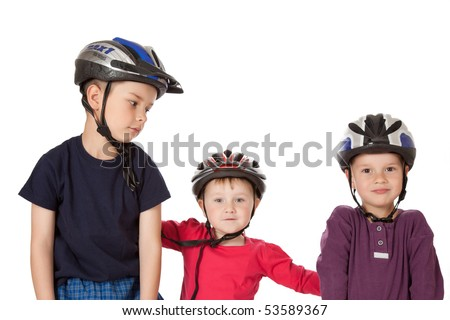 studio shot of childs in bicycle helmets - stock photo