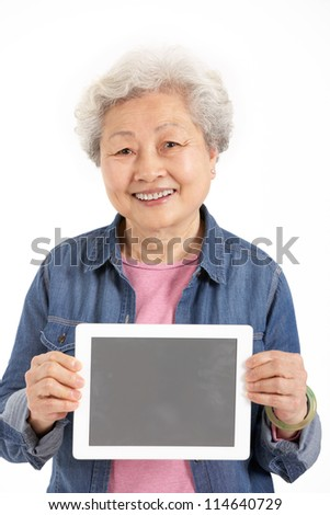Studio Shot Of Chinese Senior Woman Holding Digital Tablet