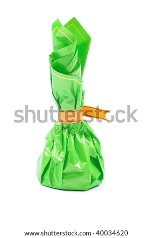 Studio shot of chocolate sweet in green package isolated on white background.