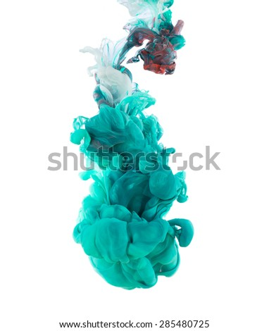 Studio shot of colored ink in water on white background - stock photo