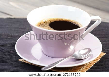 Studio shot of cup of coffee - stock photo
