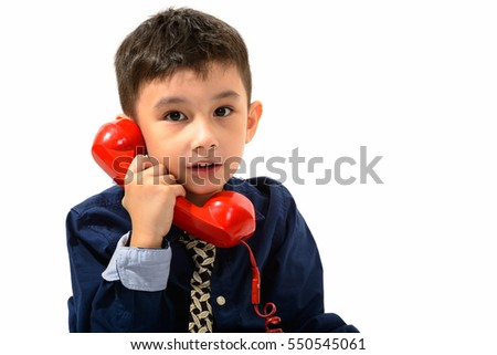 Studio shot of cute boy talking on old telephone isolated against white background