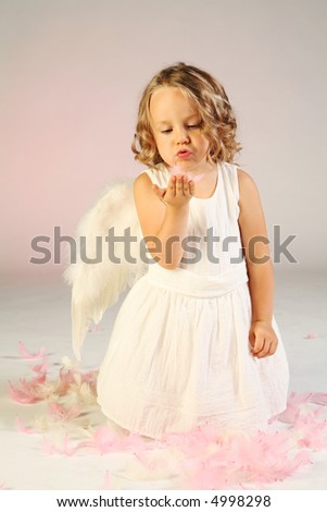 Studio shot of cute little girl as an angel.