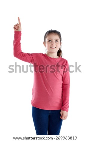 Studio shot of cute little girl showing copyspace on white background - stock photo