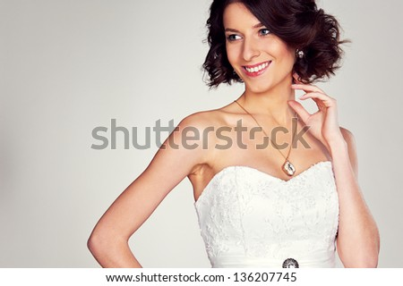 studio shot of excited bride in white dress - stock photo