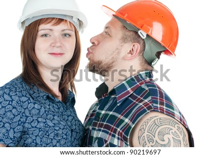 Studio shot of female engineer and brawny building contractor in hardhats, isolated over a white background - stock photo