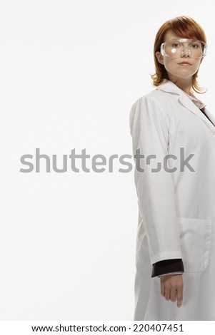 Studio shot of female lab technician - stock photo
