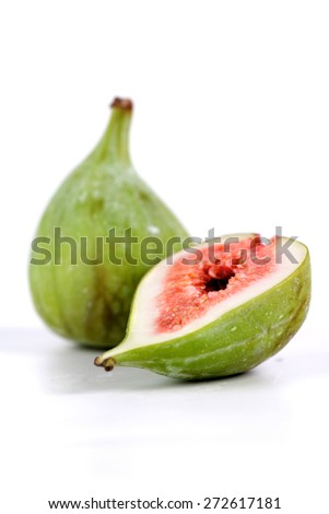 Studio shot of figs on white background - stock photo