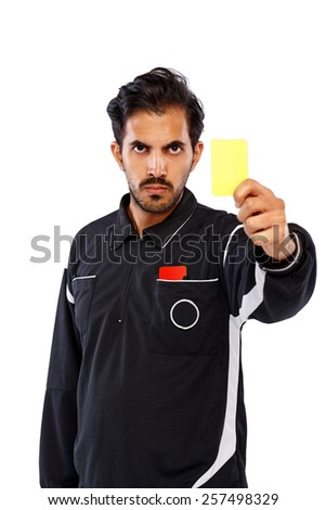 Studio shot of football referee showing yellow card on white background