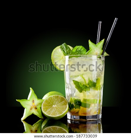 Studio shot of fresh mojito drink with slime slices, isolated on black background - stock photo