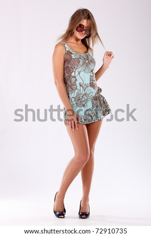 Studio shot of girl posing as a fashion model - stock photo