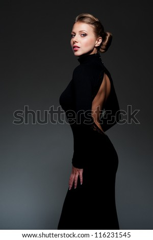 studio shot of glamor woman over dark background - stock photo
