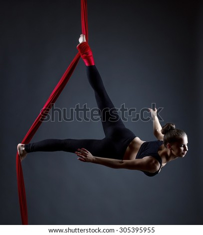Studio shot of graceful female acrobat posing - stock photo