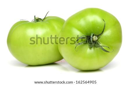 Studio shot of green tomato  - stock photo