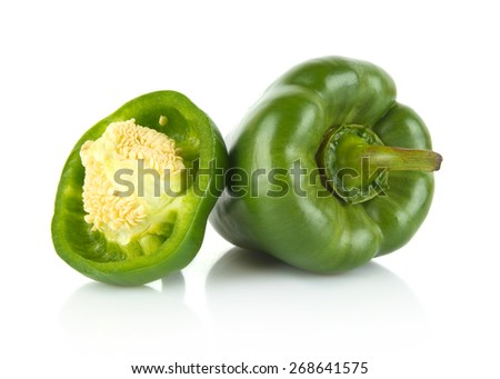 Studio shot of halved green bell peppers isolated on white background - stock photo