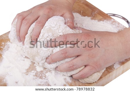 studio-shot of hands kneading dough for bread, isolated on white.