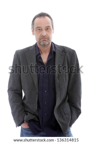 Studio shot of handsome mature man with hands in his pockets