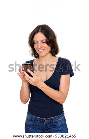 Studio shot of happy Caucasian woman using mobile phone isolated against white background