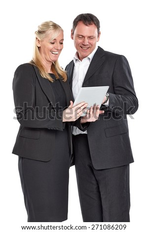 Studio shot of happy mature business colleagues using digital tablet over white background - stock photo