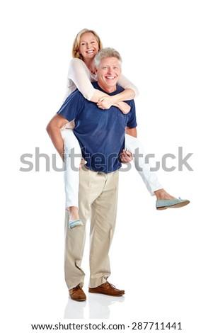 Studio shot of happy mature man piggybacking woman on white background - stock photo