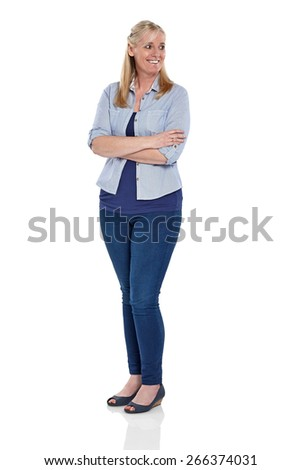 Studio shot of happy mature woman looking away at copyspace smiling on white background - stock photo