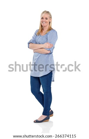 Studio shot of happy mature woman standing with her arms crossed on white background - stock photo
