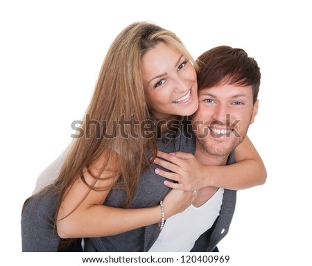 Studio shot of happy young couple isolated on white - stock photo