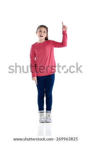 Studio shot of happy young girl pointing up at copyspace on white background - stock photo
